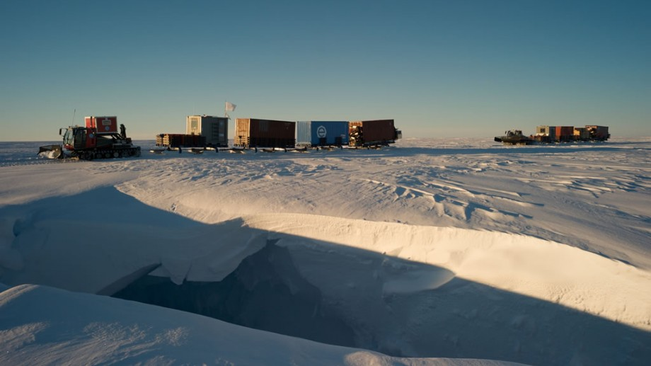 Convoy approaching a crevasse hidden by a snow bridge. In the vicinity of Princess Elisabeth Antarctica, the first